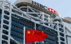 A Chinese national flag flies in front of HSBC headquarters in Hong Kong, China, July 28, 2020. REUTERS