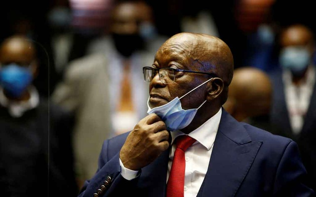 Former South African President Jacob Zuma stands in the dock after recess in his corruption trial in Pietermaritzburg, South Africa, May 26, 2021. REUTERS