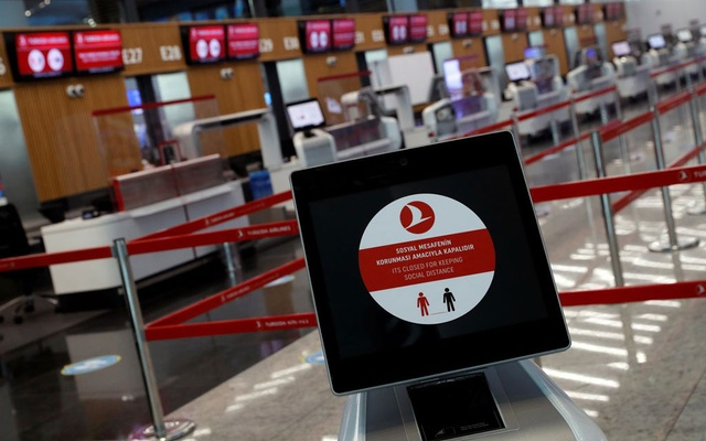 A social distancing sign is seen before the Turkish Airlines check-in counters at the international departure terminal of the Istanbul Airport amid the coronavirus disease (COVID-19) outbreak, in Istanbul, Turkey June 19, 2020. Reuters