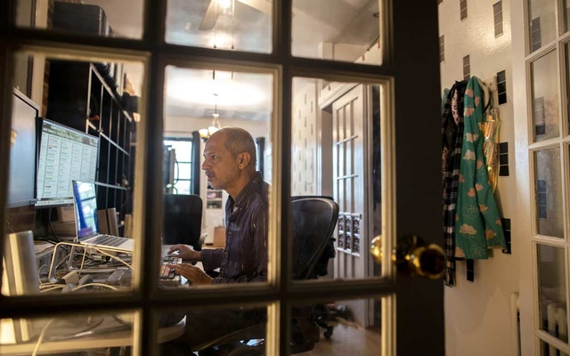 """Filmmaker Caveh Zahedi, who working on an ambitious podcast, """"365 Stories I Want to Tell You Before We Both Die,"""" edits his podcast at his home on New York on May 26, 2021. Sara Krulwich/The New York Times"""