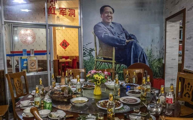 """Inside a restaurant with a mural depicting Mao Zedong in Jinggangshan, China, a town known as the """"cradle of the Chinese Revolution,"""" April 20, 2021"""