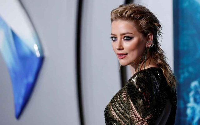 Cast member Amber Heard poses at the premiere for