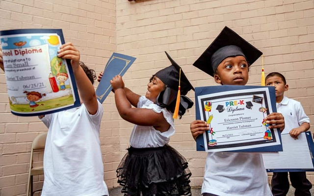 Students during a graduation ceremony at Sheltering Arms Harriet Tubman Early Childhood Education Center, a school in the Bronx, on Jun 25, 2021. Amir Hamja/The New York Times