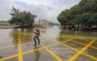 The entrance to parliament was inundated on Sunday, Jul 4, 2021 after overnight rains. Photo: Asif Mahmud Ove