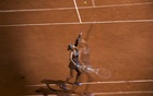 Naomi Osaka serves during her defeat of Patricia Maria Tig in the first round of the French Open in Paris on Sunday, May 30, 2021. The New York Times