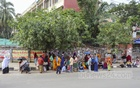 People queued up near a TCB truck to buy sugar, pulse and oil at fair prices in Mirpur-10 amid the 'strict lockdown' designed to curb the soaring rate COVID-19 infection on Tuesday, Jul 6, 2021. Photo: Asif Mahmud Ove