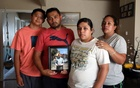 The Maldonado family, Benjamin Maldonado, Sr, second from left, and his wife Adriana Garcia right, with children Benjamine Maldonado, Jr, left, and Xitlali Raya Garcia, second from right, pose at their San Lorenzo, Calif. home on June 28, 2021, with a portrait of their son Jovani, 15, who was killed when a Tesla operating on autopilot rear-ended the family's pickup truck. The family is suing Tesla, claiming its Autopilot system was partly responsible. The New York Times