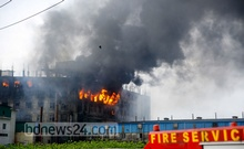 The fire on the top floors of the Hashem Foods factory building in Narayanganj's Rupganj flared up again on Friday, a day after it initially broke out, Jul 9, 2021. Photo: Mahmud Zaman Ovi
