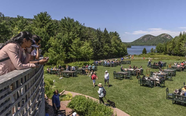 Visitors gather at Jordan Pond House in Acadia National Park in Maine on July 5, 2021. The New York Times