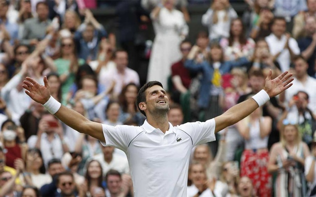 Tennis - Wimbledon - All England Lawn Tennis and Croquet Club, London, Britain - July 11, 2021 Serbia's Novak Djokovic celebrates with the trophy after winning his final match against Italy's Matteo Berrettini REUTERS/Toby Melville