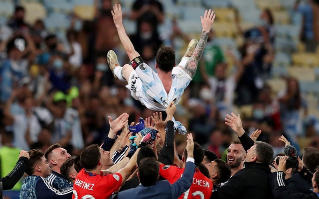 Argentina's Lionel Messi is thrown in the air by teammates after winning the Copa America. Reuters