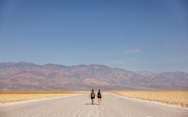 Ashley Dehetre and Katelyn Price, walk on the salt flats of Badwater Basin in Death Valley, Calif, on July 10, 2021, after a 33-hour road trip from Detroit. The New York Times