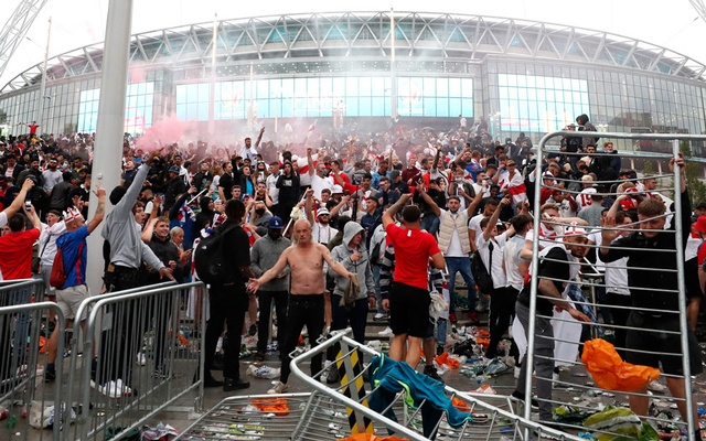 England fans celebrate their first goal while watching the match outside Wembley Stadium. Football - Euro 2020 - Final - Fans gather for Italy v England - Wembley Stadium, London, Britain - July 11, 2021. Action Images via Reuters
