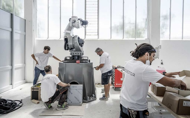 Technicians assemble a robot at the Robotor company in Carrara, Italy on June 30, 2021. Using the same marble found in Renaissance masterpieces, a team of robots is accepting commissions. Their owners say tech is essential to Italy's artistic future. (Alessandro Grassani/The New York Times)