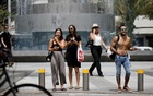 Pedestrians wait to cross a street as Israel rescinds the mandatory wearing of face masks outdoors in the latest return to relative normality, boosted by a mass-vaccination campaign against the coronavirus disease (COVID-19) pandemic, in Tel Aviv, Israel Apr 18, 2021. REUTERS