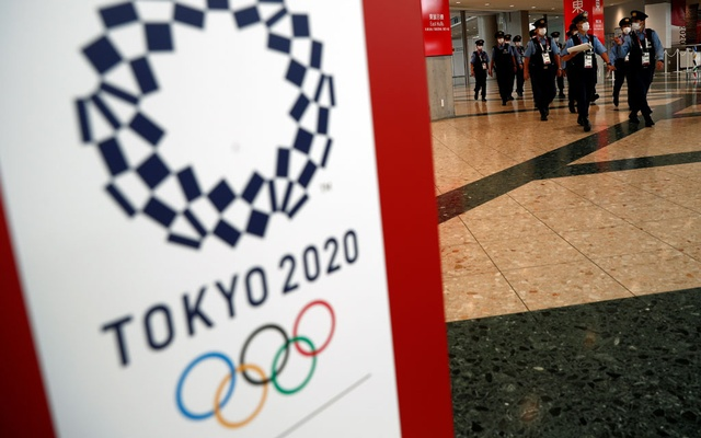 Police officers walk at the Olympic Main Press Center in Tokyo, Japan, July 14, 2021. Reuters