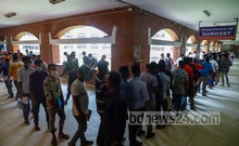 Migrant workers stand in long queues to take coronavirus vaccine shots at Suhrawardy Medical College Hospital in Dhaka on Thursday, Jul 15, 2021. Photo: Mahmud Zaman Ovi