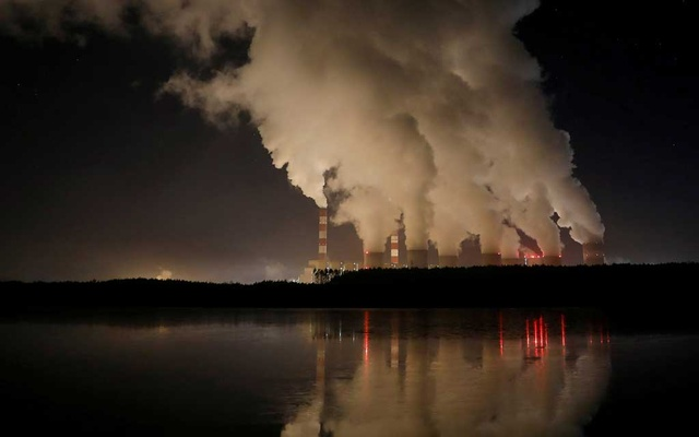 Smoke and steam billows from Belchatow Power Station, Europe's largest coal-fired power plant operated by PGE Group, at night near Belchatow, Poland December 5, 2018. Picture taken December 5, 2018. REUTERS/Kacper Pempel