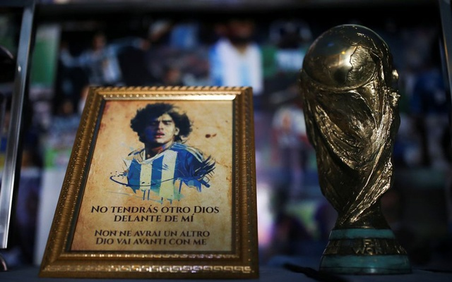 A picture of Diego Maradona and a replica of the World Cup trophy are pictured on an altar at the first Mexico's church in memory of football legend Diego Armando Maradona in San Andres Cholula, in Puebla state, Mexico July 14, 2021. REUTERS