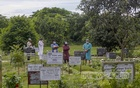 Relatives pray for people, who died from COVID-19, at Rayerbazar Graveyard in Dhaka after Jum'a prayers on Friday, Jul 16, 2021. Photo: Mahmud Zaman Ovi