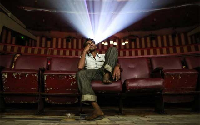 A cinema-goer watches the Bollywood movie