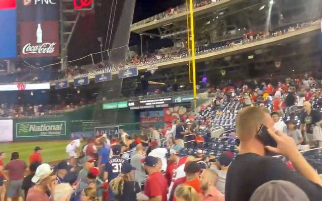 Spectators at the Nationals Park Stadium react after a shooting incident outside, in Washington, DC, US July 17, 2021 in this still image taken from a social media video. Solomon Tucker/via REUTERS