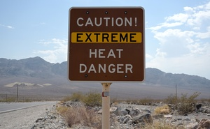 A sign warns of extreme heat in Death Valley, California, US, July 11, 2021. REUTERS/Bridget Bennett