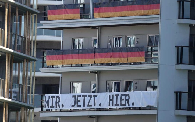 Tokyo 2020 Olympics Preview - Tokyo, Japan - July 18, 2021 Signs from the Germany Olympic team hang on the appartment building hosting Olympics participants at the Athletes Village, where two athletes have tested positive for COVID-19 REUTERS/Kim Kyung-Hoon