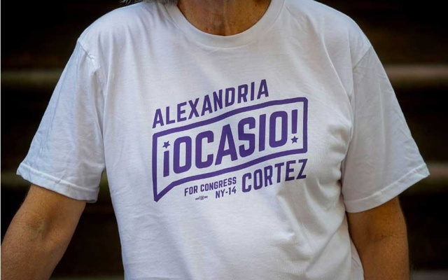 Peter Hogness poses wearing his Alexandria Ocasio-Cortez branded T-shirt in the Park Slope area of Brooklyn in New York City, US, July 16, 2021. REUTERS