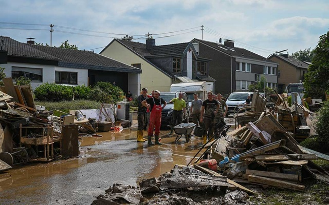 Volunteers clean the streets around the Haus Lebenshilfe care home, where 12 sleeping residents died in the flooding, in Sinzig, Germany, Saturday, July 17, 2021. If the calamitous floods that have hit Germany have an emotional centre, it is the small town of Sinzig. (Lena Mucha/The New York Times)
