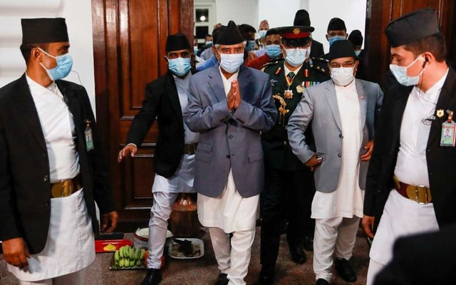 Newly appointed Prime Minister Sher Bahadur Deuba, wearing a face mask, walks after formally assuming office at Singha Durbar office complex that houses the Prime Minister's office and other ministries, in Kathmandu, Nepal July 13, 2021. REUTERS/Navesh Chitrakar/File Photo
