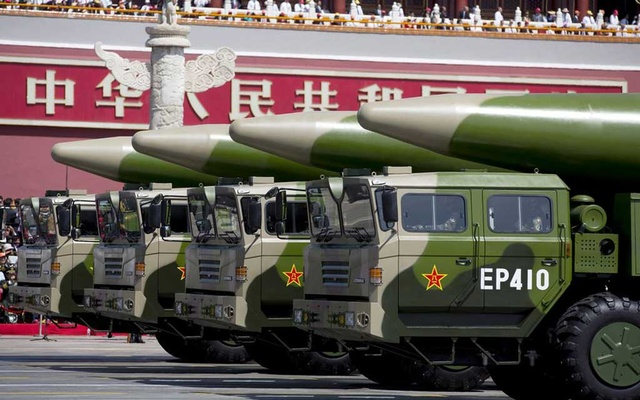 Military vehicles carrying DF-26 ballistic missiles travel past Tiananmen Gate during a military parade to commemorate the 70th anniversary of the end of World War II in Beijing Thursday Sept. 3, 2015. REUTERS