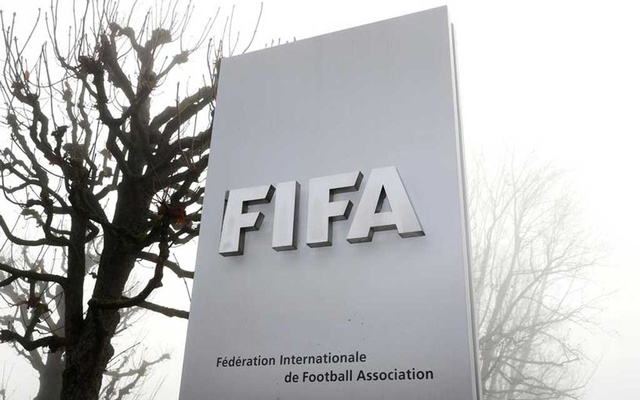 FIFA's logo is seen in front of its headquarters during a foggy autumn day in Zurich, Switzerland November 18, 2020. REUTERS/Arnd Wiegmann