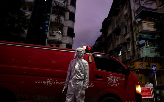 A medical staff wearing a protective suit stands near an ambulance, amid the outbreak of the coronavirus disease (COVID-19), in Yangon, Myanmar, Sept 27, 2020. REUTERS