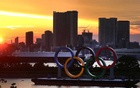 The Olympic Rings are seen in front of the skyline during sunset, three days ahead of the official opening of the Tokyo 2020 Olympic Games, in Tokyo, Japan, July 20, 2021. REUTERS/Kai Pfaffenbach