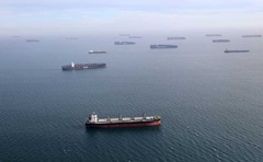 Container ships and oil tankers wait in the ocean outside the Port of Long Beach-Port of Los Angeles complex, amid the COVID-19 pandemic, in Los Angeles, California, US, Apr 7, 2021. REUTERS