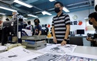 Lam Man-chung, Executive Editor-in-Chief of Apple Daily works on the final edition of the newspaper in Hong Kong, China June 23, 2021. REUTERS
