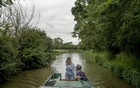 Chris Hall and Rachel Bruce on their canal boat on the Oxford Canal near Banbury, England, June 19, 2021. The New York Times.