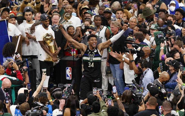 Jul 20, 2021; Milwaukee, Wisconsin, USA; Milwaukee Bucks forward Giannis Antetokounmpo (34) celebrates with the NBA Finals MVP Trophy following the game against the Phoenix Suns following game six of the 2021 NBA Finals at Fiserv Forum. Jeff Hanisch-USA TODAY Sports