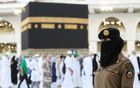 A Saudi police female officer stands guard as pilgrims perform final Tawaf during the annual Hajjj pilgrimage, in the holy city of Makkah, Saudi Arabia July 20, 2021. Reuters