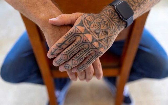Tattoos are shown on the arm US special forces veteran Jason Lilley as he poses for a portrait at his home in Garden Grove, California, US, July 9, 2021. Lilley spoke to Reuters about his experience in Afghanistan and his thoughts as the US leaves the country. Picture taken July 9, 202. REUTERS/Mike Blake
