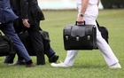 A military aide carries the so-called nuclear football as he walks to board the Marine One helicopter with US President Donald Trump for travel to Florida from the White House in Washington, US May 8, 2019. REUTERS
