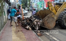 City Corporation workers remove rawhides dumped by seasonal traders from the streets of Old Dhaka's Lalbagh, Jul 22, 2021. Photo: Asif Mahmud Ove