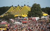 Festivalgoers enjoy the weather and stalls at Latitude Festival at Henham Park, Britain, July 22, 2021. REUTERS