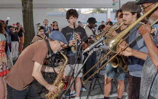 Roy Nathanson, left, in blue cap, with student musicians at the Open Streets kickoff event on Newkirk Avenue in Brooklyn this month. The New York Times