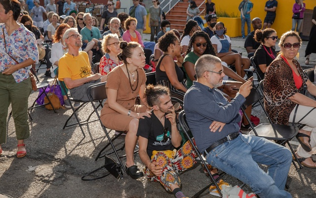 A crowd on Newkirk Avenue watching the Multigenerational Playing for the Light Big Band in July. The New York Times