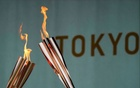 Torches are pictured during a lighting ceremony after the torch relay on a public road was cancelled due to the coronavirus disease (COVID-19) pandemic, at the Tokyo 2020 Olympic torch relay celebration in Tokyo, Japan, July 9, 2021. REUTERS