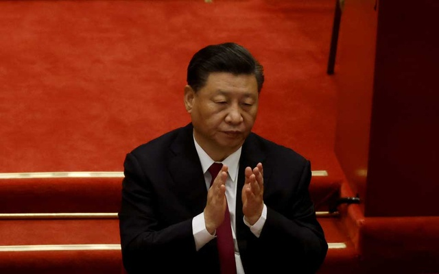 Chinese President Xi Jinping applauds at the opening session of the National People's Congress (NPC) at the Great Hall of the People in Beijing, China March 5, 2021. Reuters