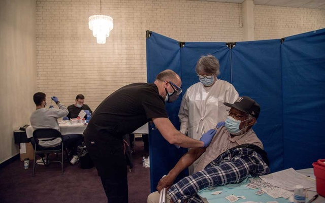 A patient, right, after receiving a COVID-19 vaccine at a vaccination site at Greater Emmanuel Institutional church in Detroit, on March 27, 2021. Biden administration officials now say older or immunocompromised Americans given the Pfizer or Moderna vaccines will probably need a third shot. (Cydni Elledge/The New York Times)