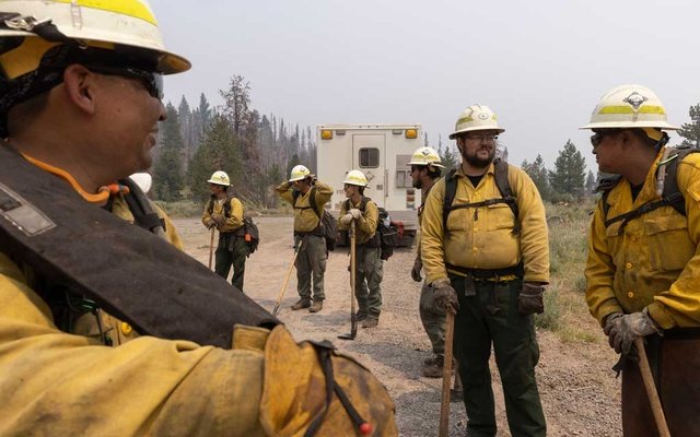 A wildfire crew from New Mexico prepares to check for smoldering debris from the Bootleg Fire near Paisley, Ore, July 23, 2021. (Kristina Barker/The New York Times)